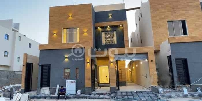 Indoor staircase villa and 2 apartments for sale in Al Munsiyah, east of Riyadh