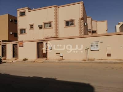 فیلا 4 غرف نوم للبيع في بريدة، منطقة القصيم - عمارة دور مع شقتين للبيع في حي الأخضر، بريدة