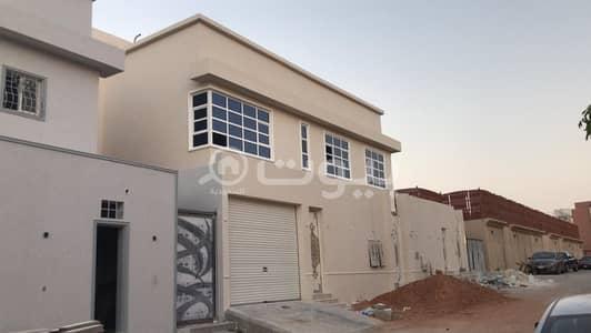 4 Bedroom Villa for Sale in Riyadh, Riyadh Region - Villa Stairs in the hallway and 2 apartments for sale in Al Nafal, North of Riyadh