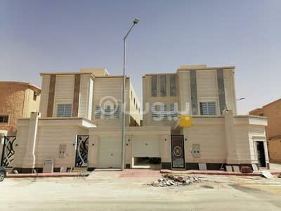 6 Bedroom Villa for Sale in Riyadh, Riyadh Region - 2 Villa staircases, a hall, and a rooftop apartment for sale in Tuwaiq, west of Riyadh