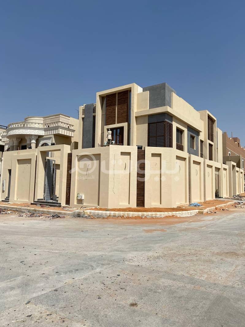 فيلا جديدة مع سطح للبيع بحي الملقا، شمال الرياض