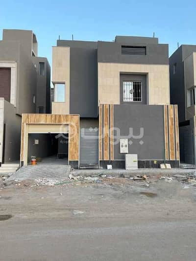 5 Bedroom Villa for Sale in Riyadh, Riyadh Region - Villa with internal stairs and an apartment for sale in Al Rimal, East Riyadh