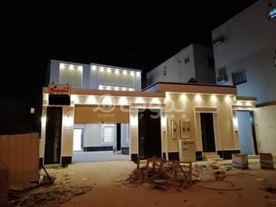 5 Bedroom Villa for Sale in Riyadh, Riyadh Region - Villa with internal stairs and two apartments for sale in Al Rimal, East Riyadh