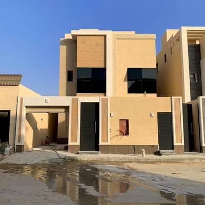 4 Bedroom Villa for Sale in Riyadh, Riyadh Region - Villa with stairs in the hallway and apartment for sale in Al Qirawan